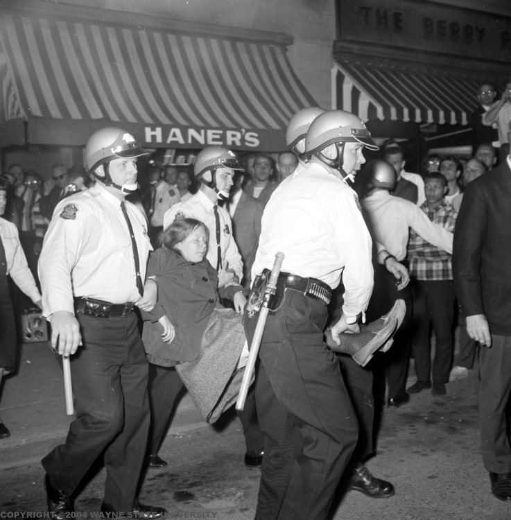 A University of Michigan student is arrested by police at the October 15th, 1965 Selective Service Office sit-in in Ann Arbor.