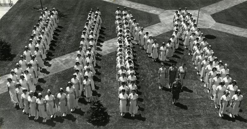 "Nurses standing in ""UM"" formation"