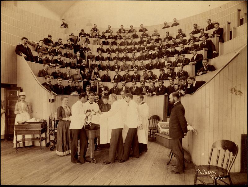 Demonstration in medical school amphitheater (includes Alice Hamilton, 3rd row, 8th from left)
