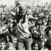 Woman Dancing Among Crowd