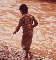 Boy Walks Along Creek Polluted By Steel Mill Effluent, July 1972
