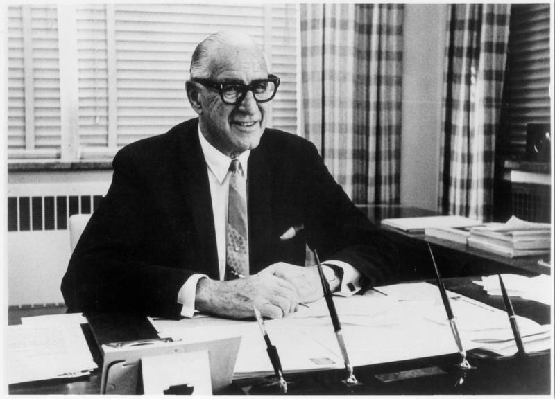 Fritz Crisler, Athletic Director, at desk