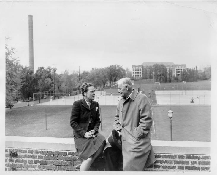 Fielding Yost and Margaret Bell on balcony of Women's Athletic Building, overlooking Palmer Field