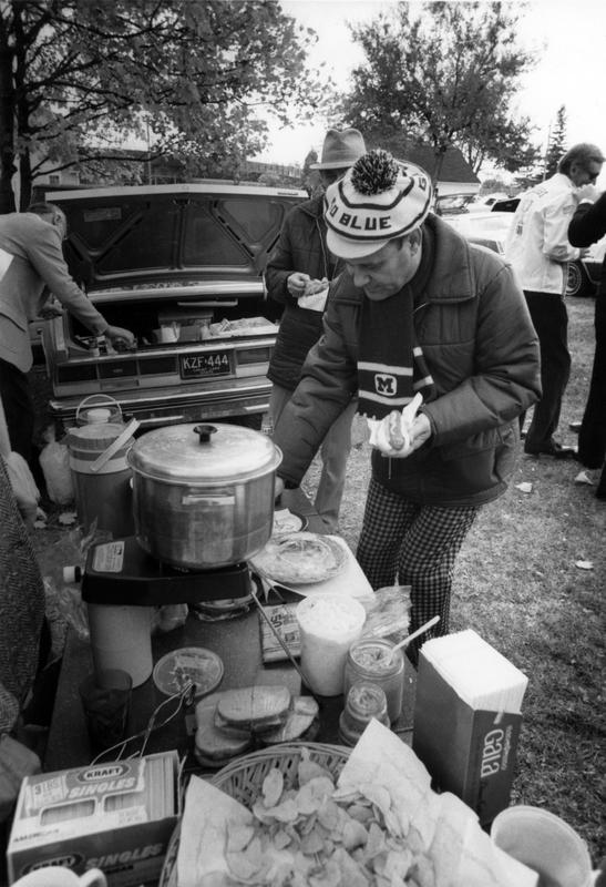 Tailgating, man in Go Blue tam<br />