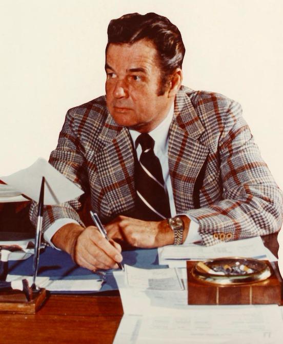 Don Canham, UM Ath. Dir., at desk