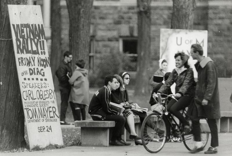 Group of students outside Law Quad, near Vietnam rally poster
