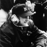 Bo Schembechler, UM Football, on sidelines wearing headphones
